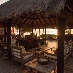 Relax on Balinese sofas while watching the sunset at Laluna's lounge.