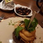 Fillet steak, onion rings, mushrooms and baked potato
