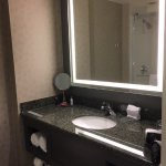 nice lighted mirror, towels and spacious countertop