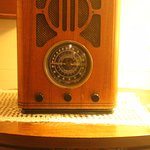Cute touches in the room like this reproduction radio