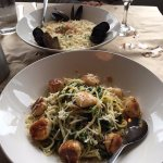 Scallop linguine in foreground and seafood orzo in background