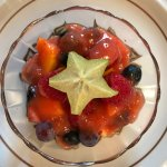 Exotic fruits and berries in a pureed fruit sauce