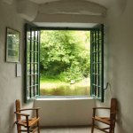 The window in the front room with (reproduction0 chairs made for W,B, Yeats.