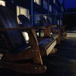 Rocking Adirondacks on patio at night