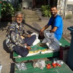 My guide Ram (right) with a coin dealer near BBD Bagh, Kolkata