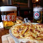 Potato topped Shepherd's Pie with a pint of Camden Hells lager