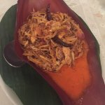 spicy salad with chicken and coconut paste in banana flower