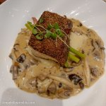 Halibut on potato with mushroom sauce