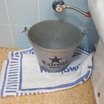 Bucket provided by Hotel toe capture leaking water from Toilet