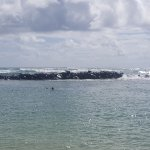Protected area with waves crashing over the rock wall.