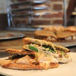 We bake our panini bread in house daily - try the Pesto Turkey!