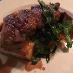 lamb on bed of dauphinoise potato, squash and greens