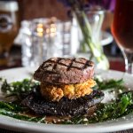 Beef Tower Grilled filet mignon stacked w/a potato cake, & portobello