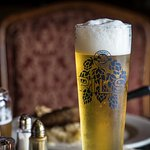 Tall glass of our award winning Pilsener paired with grilled sausage