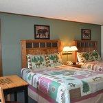 Deluxe Room, two queen beds, in room steam bath shower, fridge & coffee maker