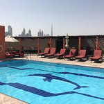 Rooftop pool with Sh Zayed Rd in the background.