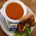 Gourmet grilled cheese, three kinds of cheese on Parmesan garlic bread and tomato bisque!