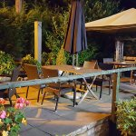 The exterior patio by night