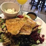 Huge amount of food on theirSalmon on their Primal Plate Salad