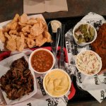 Half slab of ribs, pulled pork and rinds