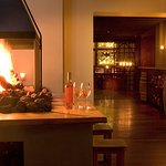 Our fireplace is the perfect spot to enjoy a wine and tapas
