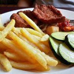 Schnitzel with apple saukeraut, zuchinni, and french fries
