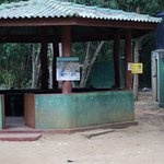 The rest area and drop squat toilet in the background