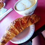 Latte and Croissant. Yes that is a bowl of coffee. It was delicious.