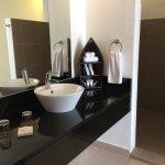 Nice amenities and spacious bathroom but need more bath mats.
