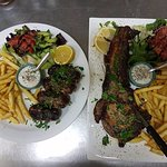 Left dish, Sieftalia, traditional Cypriot meatballs! On the right, our famous pork chop!