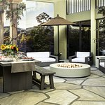 Patio with dinner settings and fire pit
