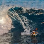 Surfer beneath Blue Point infinity pool catches big wave. Shot with Olympus OMD EM1 using teleph