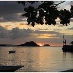 sundown seen the bar tip of the blue corals resort