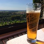 A stunning river and countryside view, enhanced by an ice-cold Lobkowicz beer