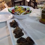 Stuffed vine leaves and Greek salad starter
