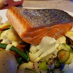 Perfectly cooked salmon grill with well flavored veges