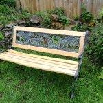 Lovely miniature bench in the corner of the beer garden!