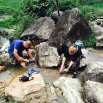 Washing in the Giang Ta Chai Waterfall