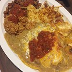 Huevos Rancheros in Salsa Verde Country steak breakfast  Us with the car in the wall