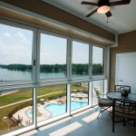 "Our two bedroom condos have ""roll back"" windows for an open balcony or closed sunroom effect."