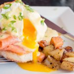 Eggs Benedict at Sage&Stone is served with our house salad and roasties.
