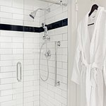 Get Invigorated--all King Suites feature a spacious tiled shower with dual shower heads
