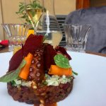 Grilled octopus, beans ragout, baby spinach, cauliflower, pickle carrots, cayenne pepper chips,