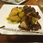 Chicken breast stuffed with plaintain and side of creole potatoes