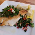 Pan fried sea bass with a broccoli, brazil nut and pomegranate salad with a side of dill potatoe