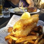 Fish and chips in foreground, Beef Wellington in the background