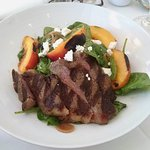 grilled Piemontese skirt steak salad with goat cheese and grilled peaches; Amazing!