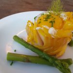 Smoked Haddock parcel with cream cheese and chive, on a bed of asparagus
