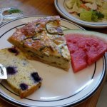 Quiche w/ slices of blueberry cake & watermelon