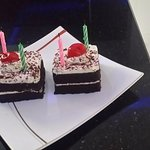The cute birthday cakes with two candles on each.